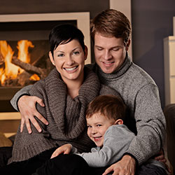 Family by the fireplace